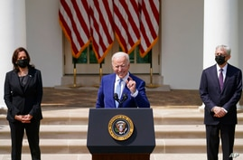 President Joe Biden, accompanied by Vice President Kamala Harris, and Attorney General Merrick Garland, speaks about gun…