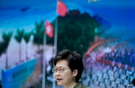 Hong Kong Chief Executive Carrie Lam speaks during a press conference in Hong Kong, Tuesday, April 13, 2021. Lam said Tuesday…