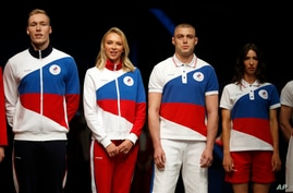 Athletes display the Olympic uniforms for Russian athletes in Moscow, Russia, Wednesday, April 14, 2021. Russia presents its…