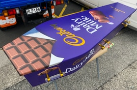 This photo provided by Ross Hall, shows a chocolate bar designed casket in Auckland, New Zealand on April 30, 2020. Auckland…
