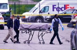 A body is taken from the scene where multiple people were shot at a FedEx Ground facility in Indianapolis, Friday, April 16,…