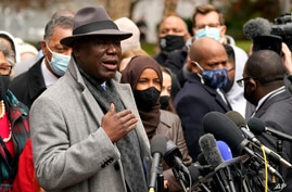Ben Crump, left, the attorney representing George Floyd's family, speaks during a news conference outside of the Hennepin…