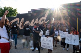 People gather before a march in Atlanta, April 20, 2021, after former Minneapolis police Officer Derek Chauvin was found guilty.