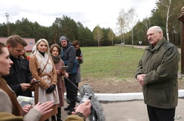 Belarusian President Alexander Lukashenko talks with media during his visit to the Polesie State Radioecological Reserve,…