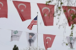 Turkish flags and banners depicting Mustafa Kemal Ataturk, the founder of modern Turkey, decorate a street outside the United…