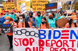 Supporters of immigration reform march while asking for a path to citizenship and an end to detentions and deportations,…