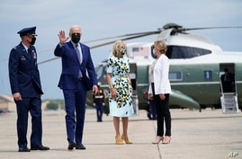 President Joe Biden waves as he and first lady Jill Biden walk to board Air Force One for a trip to Georgia to mark his 100th day in office, April 29, 2021, in Andrews Air Force Base, Md.