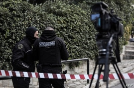 Greek police set up a security perimeter near the house of Giorgos Karaivaz, a veteran crime journalist, after he was shot dead in Athens, April 9, 2021.