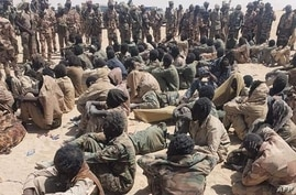 This image made available by the Chadian Army, April 18, 2021, shows alleged rebel soldiers after they were captured following clashes with the Chadian army, in Nyze, Chad, April 17, 2021.