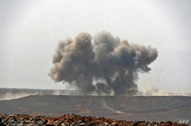 FILE - Smoke billows during clashes between forces loyal to Yemen's Saudi-backed government and Houthi rebel fighters in Yemen's northeastern province of Marib, March 5, 2021.