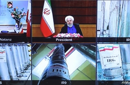 A handout picture provided by the Iranian presidential office April 10, 2021, shows a screen grab from a videoconference showing views of centrifuges and devices at Iran's Natanz uranium enrichment plant, as well as Iranian President Hassan Rouhani.
