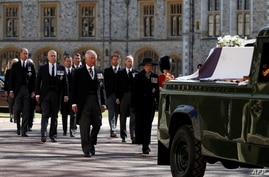 Britain's Prince Charles and other members of the royal family lead the ceremonial funeral procession of Britain's Prince Philip, to St. George's Chapel, at Windsor Castle, west of London, April 17, 2021.