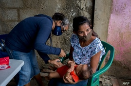 A child is vaccinated in Barcelona, Anzoategui State, Venezuela, March 16, 2021.