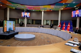 European Commission President Ursula von der Leyen, center, and European Council President Charles Michel hold a video conference with Turkey's President Recep Tayyip Erdogan, at the European Council building in Brussels, Belgium, March 19, 2021.
