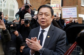 Myanmar's ambassador to the UK, Kyaw Zwar Minn speaks to the media outside the Myanmar Embassy in London, April 8, 2021.