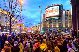 People gather to attend the opposition rally in support of jailed opposition leader Alexei Navalny in the historical center of Moscow, Russia, April 21, 2021.