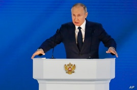 Russian President Vladimir Putin gives his annual state of the nation address in Manezh, Moscow, April 21, 2021.