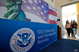 FILE - People arrive before the start of a naturalization ceremony at the U.S. Citizenship and Immigration Services Miami Field Office in Miami, Florida, Aug. 17, 2018.