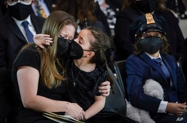 """Abigail Evans, 7, Logan Evans, 9, the children of the late U.S. Capitol Police officer William """"Billy"""" Evans, sit with their mother ShannonTerranova, left, during a memorial service as Evans lies in honor in the Rotunda at the U.S. Capitol in Washington."""