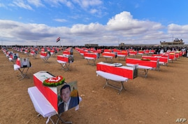 A woman reacts during a a mass funeral for Yazidi victims of the Islamic State (IS) group in the northern Iraqi village of Kojo…