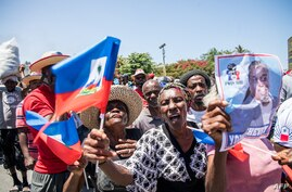 Haitians demonstrate during a protest to denounce the draft constitutional referendum carried by the President Jovenel Moise on…
