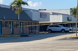 Police tape blocks the scene of a shooting near a Billiard's club that was rented for a concert after three gunmen killed two…