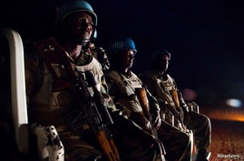 FILE - UNAMID peacekeepers from Ethiopia prepare to go on a night patrol.