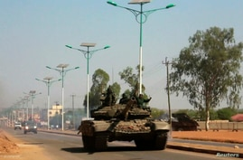 A military tank patrols along one of the main roads in the South Sudanese capital Juba December 16, 2013. The South Sudanese…