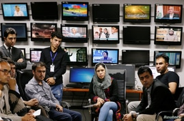 FILE - Afghan journalists attend a meeting in the Tolo newsroom, in Kabul, Afghanistan September 7, 2018.
