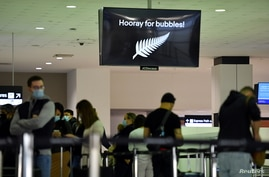 Departure passengers to New Zealand wait to check in, as quarantine-free travel between Australia and New Zealand begins.