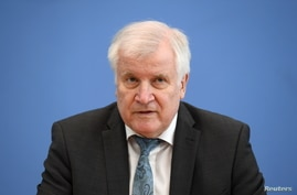 German Interior Minister Horst Seehofer attends a news conference on politically motived crimes in Germany, in Berlin, Germany May 4, 2021.