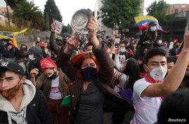 Demonstrators participate in a protest against powerty and police violence, in Bogota, Colombia May 4, 2021. REUTERS/Nathalia…