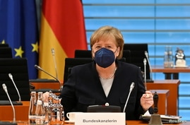 German Chancellor Angela Merkel takes her seat during the weekly cabinet meeting at the chancellery in Berlin, Germany May 5,…