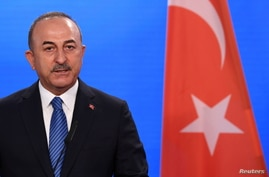 FILE PHOTO: Turkish Foreign Minister Mevlut Cavusoglu gives a statement to the media following a meeting with German Foreign…