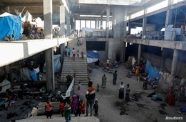 FILE PHOTO: Displaced people are seen inside a building under construction at the Shire campus of Aksum University, which was…