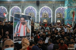 Mourners attend a funeral of Iraqi civil society activist Ehab al-Wazni, who was killed by unidentified gunmen, in Karbala.