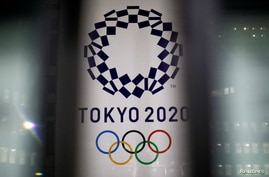 FILE PHOTO: The logo of Tokyo 2020 Olympic Games that have been postponed to 2021 due to the coronavirus disease (COVID-19)…