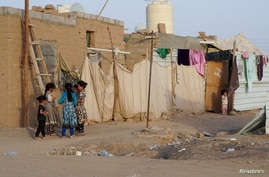 Girls play at a makeshift camp for internally displaced people (IDPs) in the oil-producing Marib province, Yemen May 10, 2021.