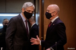 Attorney General Merrick Garland speaks with U.S. Homeland Security Secretary Alejandro Mayorkas as they arrive for a hearing…