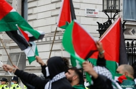 Pro-Palestinian demonstrators protest during a demonstration following a flare-up of Israeli-Palestinian violence, in London,…