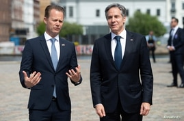 Danish Foreign Minister Jeppe Kofod stands next to U.S. Secretary of State Antony Blinken as he arrives for meetings.