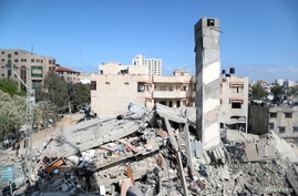 A view shows the remains of a building after it was destroyed in Israeli air strikes, amid a flare-up of Israeli-Palestinian fighting, in Gaza City May 18, 2021.