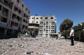 A Palestinian man views the damage to the health ministry headquarters in the aftermath of Israeli air strikes, in Gaza City May 19, 2021.