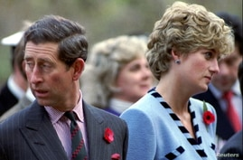 FILE PHOTO: Princess Diana and Prince Charles look in different directions, November 3, during a service held to commemorate…