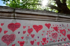 Dedications to coronavirus disease victims are seen written on the National Covid Memorial Wall in London, Britain, May 27, 2021.