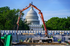 A concrete pump frames the Capitol Dome during renovations and repairs to Lower Senate Park on Capitol Hill in Washington,…