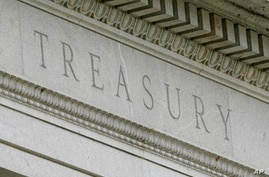FILE - This May 4, 2021 file photo shows the Treasury Building in Washington. The U.S. Treasury Department said Thursday, May…