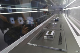 FILE - In this April 30, 2019, file photo, Samsung Electronics' microchips are displayed at its store in Seoul, South Korea…