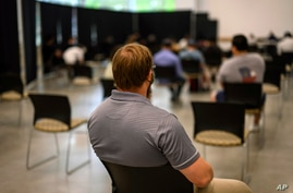 Georgia Tech employee Adam Jackson waits after receiving a Pfizer COVID-19 vaccination at the Vaccination Site on the campus of…