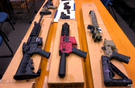 """FILE - This Nov. 27, 2019, file photo shows """"ghost guns"""" on display at the headquarters of the San Francisco Police Department…"""